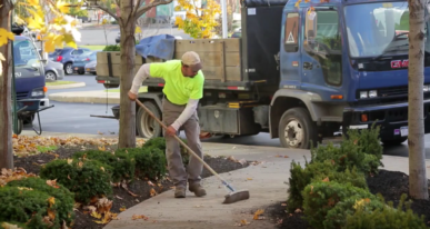 sweeping sidewalks in office park